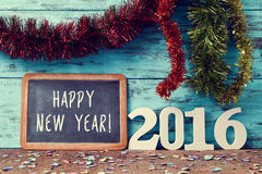 Confetti, tinsel and text happy new year 2016 Stock Photo