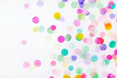 Confetti on white background. Colorful confetti on white background with copy space royalty free stock image