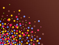 Confettis corner. Brown background with colorful confettis Stock Photos