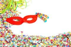 Confettis, masque, flammes Images libres de droits