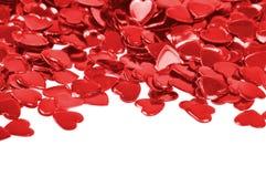 Confettis rouges de coeurs d'isolement Photos stock