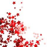 Confettis rouges en forme d'étoile Image stock