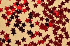 Confettis sous forme d'étoiles rouges Images libres de droits