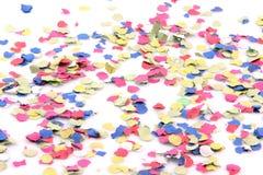 Confettis sur le blanc Images stock