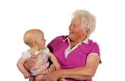 Confiar en al bebé joven con la abuela Fotografía de archivo libre de regalías
