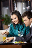 Confidence. Young woman and the man discuss something on the laptop screen in cafe stock images