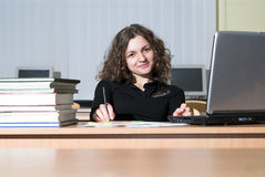 Confidence. Confident female student is waiting for something and playing with her pen Royalty Free Stock Photography