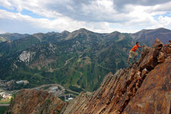 Confidence. Hiker with confidence nears the top with a few more climbing moves to make Royalty Free Stock Images