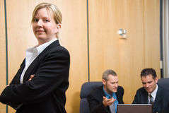 Confidence. 3 business people with woman in foreground stock photos