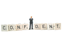 Confidence. A manager standing in the word confident stock images
