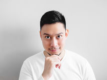 Confidence Asian man. Confidence Asian man with hand touch his chin Stock Photos