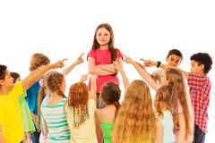 Confidence in audience kids point finger at girl Stock Photo