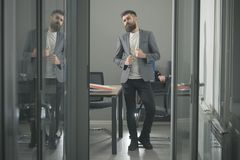 Confidence, bearded man look out room door. Confidence and success concept.  Royalty Free Stock Photography