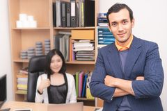 Confidence business man with co worker. In background stock images