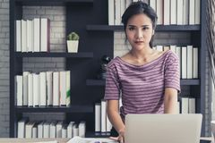 Confidence business woman working in office. Confidence business woman is working in office royalty free stock photography