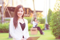 Confidence business woman is working together in a park outd. Two confidence business woman is working together in a park outdoor stock image