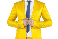 Confidence, businessman in a gold suit on a white background royalty free stock image