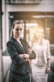 Confidence businesswoman standing in office. Portrait of confidence businesswoman standing in office stock photo