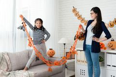 Confidence girl showing Halloween decoration Royalty Free Stock Photography