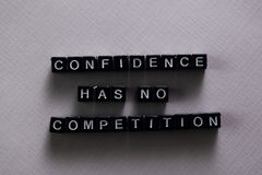Confidence has no competition on wooden blocks. Motivation and inspiration concept stock photos