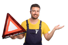Confidence mechanic holding one wrench Stock Photography