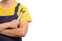 Confidence mechanic holding one wrench in his hand isolated on w Royalty Free Stock Photography