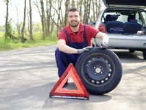 Confidence mechanic. Repairing a vehicle breakdown stock image