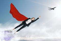 Confidence and protection concept. Flying superhero businesswoman with airplane on sky background. Confidence and protection concept royalty free stock images