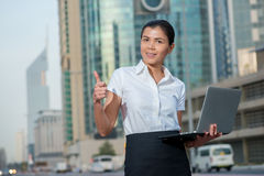 Confidence. Successful businesswoman standing in the street in f Royalty Free Stock Photos