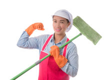Confidence successful young housewife standing and holding mop r. Eady for cleaning services. isolated on white background. housework and household concept royalty free stock photos