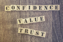 Confidence Value Trust quote. On a wooden background stock photography