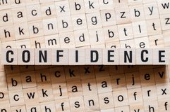 Confidence word concept. On cubes royalty free stock photography