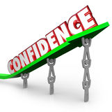 Confidence Word Team Lifting Arrow Believe Yourself. Confidence word lifted on arrow by team working together to be confident that success is achievable through Stock Photo