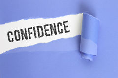 Confidence. Word on torn page royalty free stock image