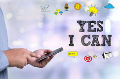 CONFIDENCE   YES I CAN. Person holding a smartphone on blurred cityscape background Stock Photo