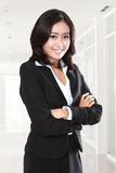 Confidence young business woman. Smiling confidence young business woman in the office stock images