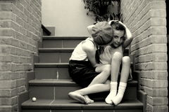 Confidences between two children. On the steps of a house stock images