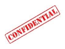 Confidencial en sello de goma rojo. Fotografía de archivo libre de regalías