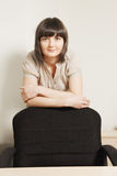 Confidend businesswoman behind chair Stock Photos