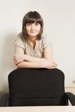 Confidend businesswoman behind chair Stock Photos