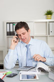 Confident accountant talking on mobile phone Stock Photography