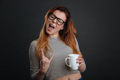 Confident active girl rocking morning coffee. Feel the vibe. Lively vibrant creative lady feeling energetic after having a morning drink and enjoying the moment Royalty Free Stock Images