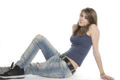 Confident adolescent. Young adolescent posing over white background Stock Images