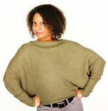 Confident adult female in sweater Stock Photos
