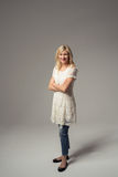 Confident Adult Lady in White Dress and Jeans Royalty Free Stock Image
