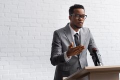 Free Confident African American Business Speaker On Stock Photos - 180402883