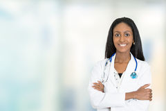 Confident African American female doctor medical professional. Portrait confident African American female doctor medical professional standing isolated on stock images
