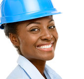 Confident African American woman architect smiling close-up whit. Confident African American woman architect smiling Stock Photography