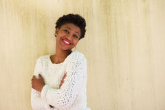 Confident african american woman smiling with white sweater Royalty Free Stock Photography