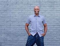 Confident african man smiling against gray background Stock Photography